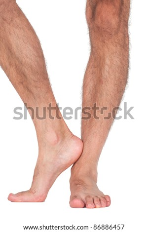 Nude man's legs isolated on white background - stock photo