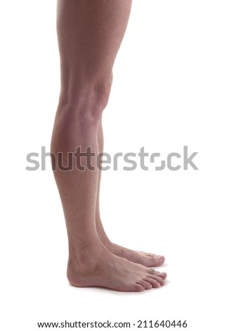 Nude man's legs isolated. side view - stock photo