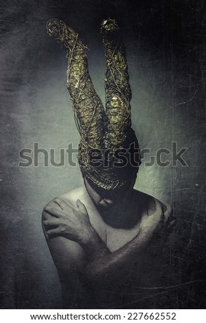 Nude man with big horns - stock photo