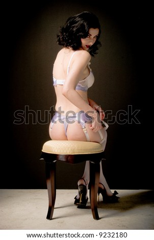 Nude model shot in the studio, pin-up style. - stock photo