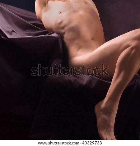 Nude muscle male torso with droplet in his chest - stock photo