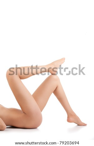 nude woman laying down showing only legs - stock photo