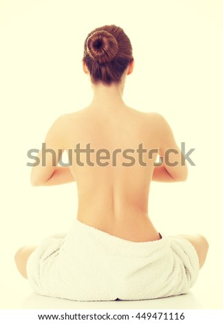 Nude woman practicing yoga - stock photo