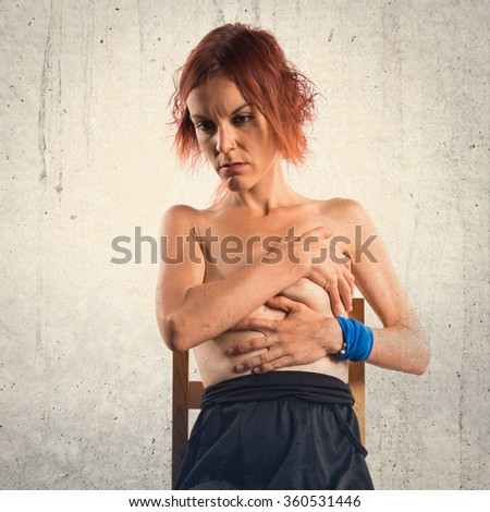 Nude woman sitting on wooden chair