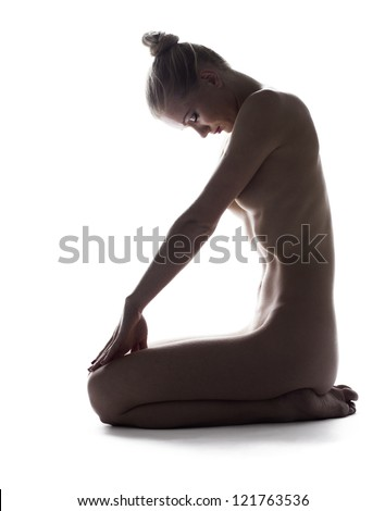 Nude young woman in studio - stock photo