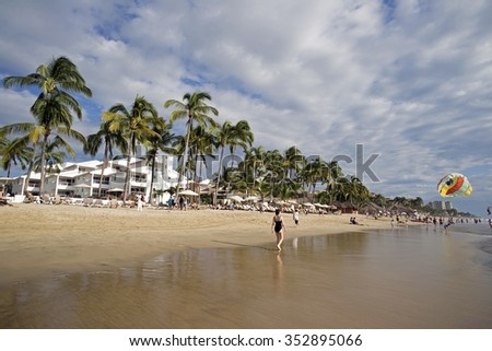 NUEVO VALLARTA, MEXICO - NOV.28, 2015 -  New Puerto Vallarta is popular  tourists destination. Beautiful beaches and clear warm water of the North Pacific Ocean are attractive to swimmers all year. - stock photo