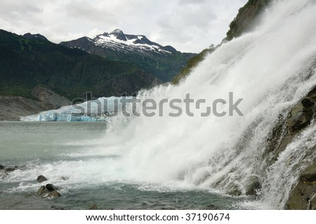 Nugget Falls with Mendenhall Glacier and Mountains in the Distance, Juneau, Alaska - stock photo