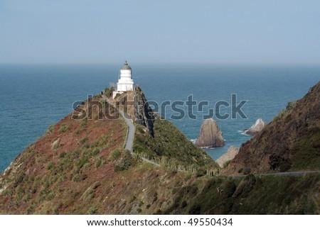 Nugget Point lighthouse, Catlins Coast, New Zealand - stock photo