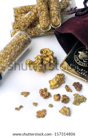nuggets and gold bullion in studio on white background - stock photo