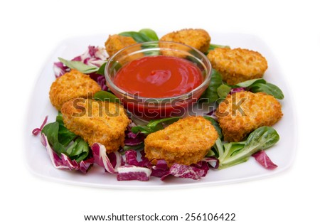 Nuggets of chicken salad on white background - stock photo
