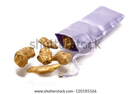 Nuggets of gold  on a white background. - stock photo
