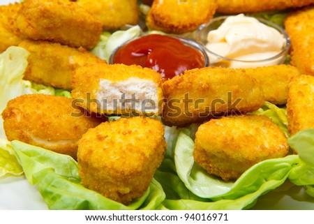 nuggets with ketchup and mayonnaise - stock photo