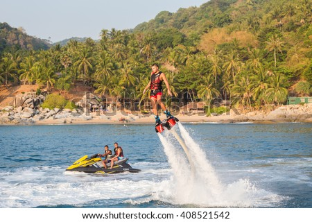 Nui beach - Phuket - March 31, 2016: An unidentified guy is playing with a new water sport called fly board at Nui bay in Phuket, Thailand