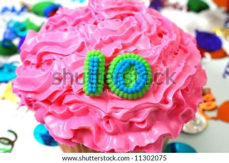 Number 10 celebration cupcake with confetti. - stock photo