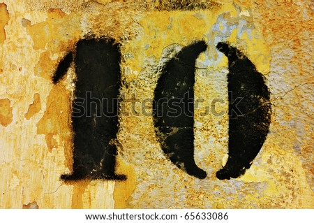 number 10 drawn on a peeled wall