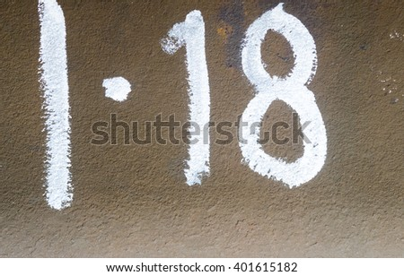 Number eighteen typed on the metall plate - stock photo