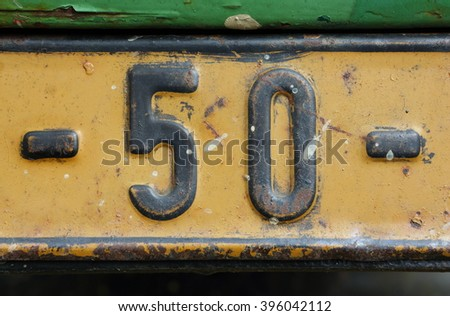 number fifty on a iron notice board