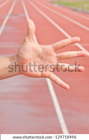 Number Five on Running Track Arena - stock photo