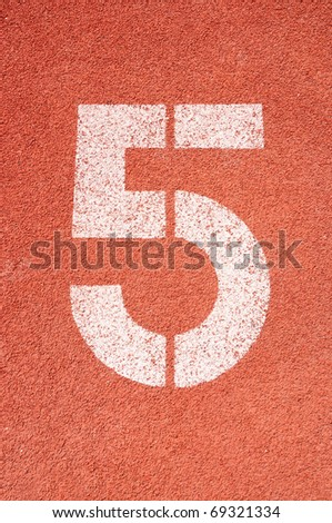 Number five on the start of a running track - check my portfolio for other numbers - stock photo