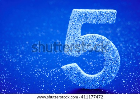 Number five silver color over a blue background. Anniversary. Horizontal