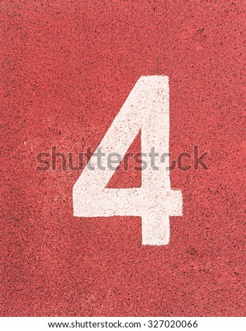 Number four,White track number on rubber racetrack, texture of running racetracks in small stadium. - stock photo