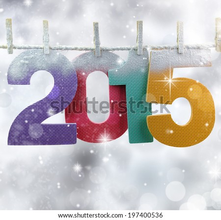 Number 2015 hanging on a clothesline in a glittery lights background - stock photo