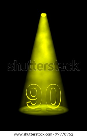 Number 90 illuminated with yellow spotlight on black background - stock photo