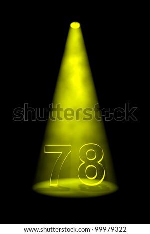 Number 78 illuminated with yellow spotlight on black background - stock photo