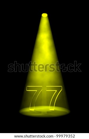 Number 77 illuminated with yellow spotlight on black background - stock photo