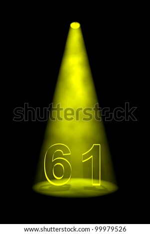 Number 61 illuminated with yellow spotlight on black background - stock photo
