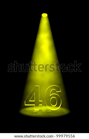 Number 46 illuminated with yellow spotlight on black background - stock photo