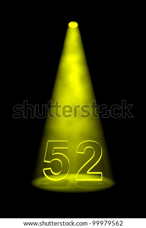 Number 52 illuminated with yellow spotlight on black background - stock photo