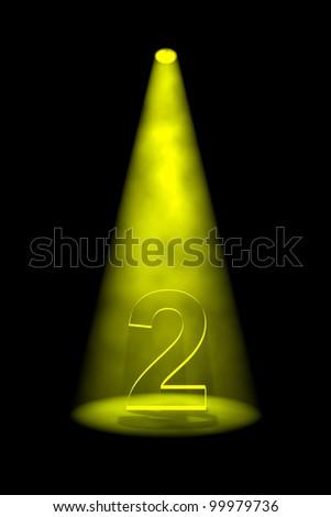 Number 2 illuminated with yellow spotlight on black background - stock photo