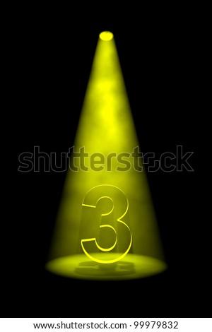 Number 3 illuminated with yellow spotlight on black background - stock photo