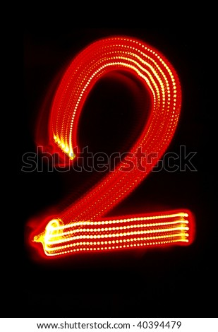 "Number ""2"" made of red light"