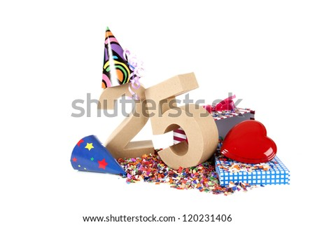 Number of age in a colorful studio setting with paper party hats, a red heart and gifts on a bottom of confettie - stock photo