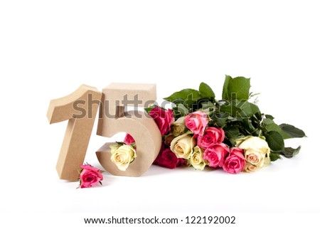 Number of age in a colorful studiosetting,surrounded with roses - stock photo