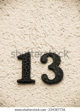 number 13 on a house wall  - stock photo
