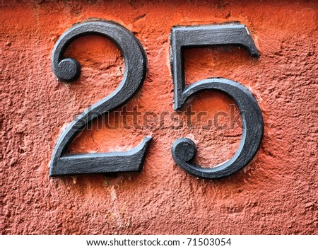 Number 25 on house wall - stock photo