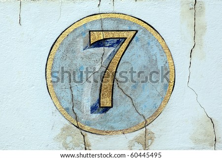 Number 7 on old painted wall - stock photo