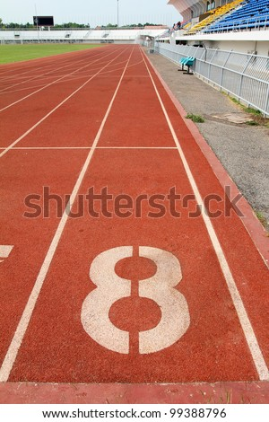 Number 8 on running track - stock photo