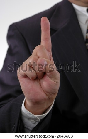 Number one gesture with hand on business suit - stock photo