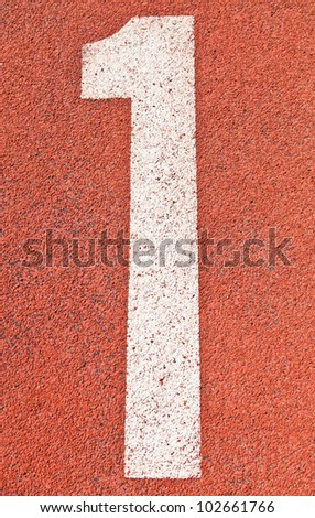 Number one on the start of a running track - check my portfolio for other numbers