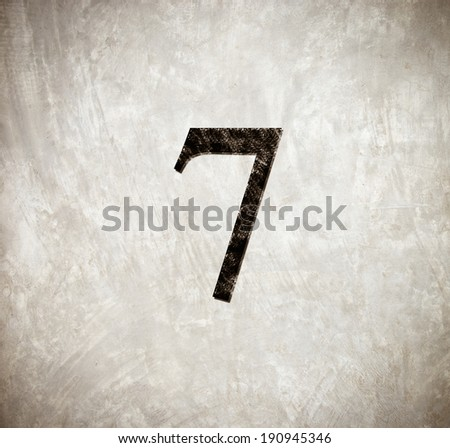 Number seven on grunge cement wall. - stock photo