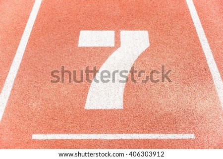 Number seven on running race lane