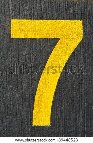 Number seven painted on black floor - check my portfolio for other numbers