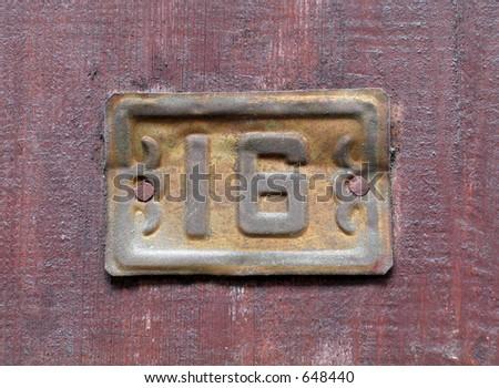 Number sixteen on a door - stock photo