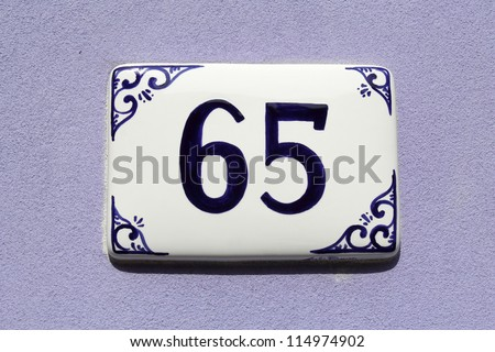 number sixty-five, house address plate number