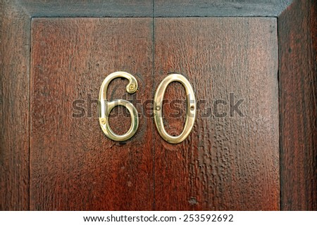 Number sixty on a door - stock photo