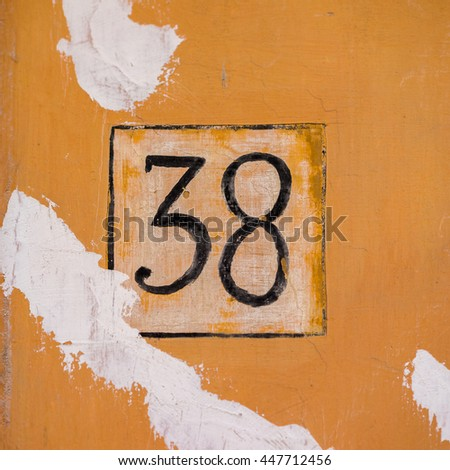 Number thirty eight hand painted on a wall - stock photo